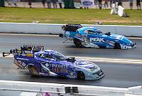 Sep 25, 2016; Madison, IL, USA; NHRA funny car driver Jack Beckman (near) races alongside John Force during the Midwest Nationals at Gateway Motorsports Park. Mandatory Credit: Mark J. Rebilas-USA TODAY Sports