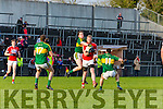 Kerry Tadhc Morley punches the ball away from Ruairi deane Cork to team mates Michael Geaney and Brendan O'Sullivan during the McGrath cup clash in Mallow on Sunday