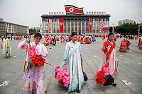 Participants leave the capital's main ceremonial square after a mass rally and parade, a day after the ruling party wrapped up its first congress in 36 years by elevating him to party chairman, in Pyongyang, North Korea May 10, 2016.  REUTERS/Damir Sagolj