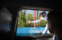 Fabian Cancellara (SUI/Trek-Segafredo) checks in at the team car during the recon of the prologue telling his mechanic Roger Teel &quot;It will be like riding into an arena this afternoon.&quot; <br /> <br /> stage 1: Apeldoorn prologue 9.8km<br /> 99th Giro d'Italia 2016