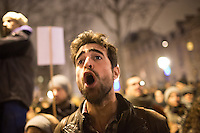 A man yells as he joins others demonstrating at Place de la Republique following the massacre at Charlie Hebdo in Paris where masked gunmen killed 12 people. Paris, France, (Jan. 7, 2015).