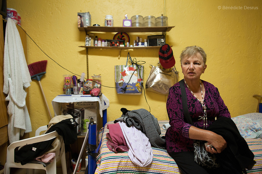 Sonia, a resident of Casa Xochiquetzal, in her bedroom at the shelter in Mexico City, Mexico on October 9, 2012. Sonia is from Sonora and is 62. At age 14, she received a bullet wound in her head after being raped. Since then, her left arm and leg are paralyzed. But she turned to sex work anyway. Casa Xochiquetzal is a shelter for elderly sex workers in Mexico City. It gives the women refuge, food, health services, a space to learn about their human rights and courses to help them rediscover their self-confidence and deal with traumatic aspects of their lives. Casa Xochiquetzal provides a space to age with dignity for a group of vulnerable women who are often invisible to society at large. It is the only such shelter existing in Latin America. Photo by Bénédicte Desrus