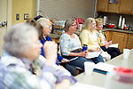 Woodbury, CT- 15 May 2017-051517CM02-  A group of women listen in as Chef Marianne De Silva prepares a picnic style cooking class at the Woodbury Senior Center on Monday. De Silva demonstrated on how to prepare a picnic food menu which included grilled turkey burgers, Southwestern macaroni salad and individual chocolate strawberry shortcakes.    Christopher Massa Republican-American