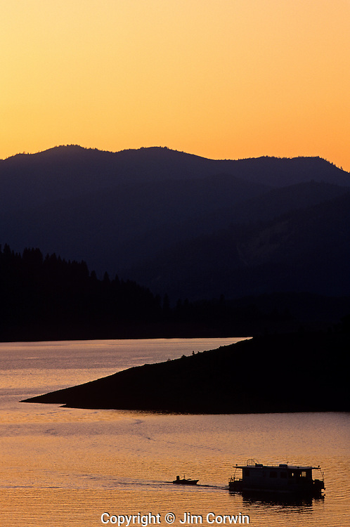 Silhouetted House boat on Shasta Lake near Redding Northern California USA