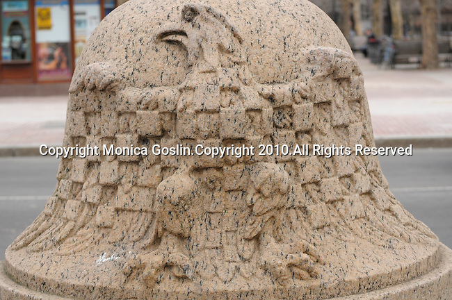 An eagle carved onto a post in front the Public Library in Boston, MA.