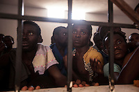 Sub-Saharan illegal migrants and refugees are pictured begging for their release in the Zawiyah detention centre. The centre's director (not pictured) stands in front of the cell, threatening to beat them with a stick if they do not calm down, leading to panic on the part of the detainees.