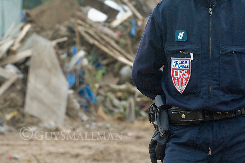Police continue to guard the clearance of the Calais refugee 'jungle' camp as refugees from Iraq and Sudan remain destitute on the streets of the port town.