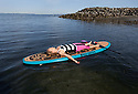 PE00297-00...WASHINGTON - Carly Hayden doing paddle board yoga in the Puget Soundat at Brackett's Landing North, Edmonds.  (MR #H13)