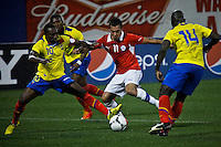 Chile's player Eduardo Vargas ( C) fights for the ball with Ecuador's players Walter Ayovi (L) and Segundo Castillo ( R) during their friendly match at the Citi-Field Stadium in New York, August 15, 2012. Photo by Eduardo Munoz Alvarez / VIEW.