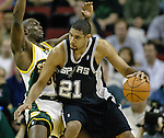 San Antonio Spurs Tim Duncan, R, knocks Seattle SuperSonics Reggie Evans, L, off balance as he moves to the basket in the first period of their  Western Conference Semifinals Game 4 in Seattle, Washington on Sunday, 15 May 2005.   Jim Bryant Photo. &copy;2010. All Rights Reserved.