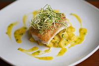 QUEENS, NY - April 10, 2015: Sea Bass with fennel potatoes and saffron sauce at Casa del Chef in Woodside.<br /> <br /> Clay Williams for New York Times.<br /> <br /> &copy; Clay Williams / claywilliamsphoto.com