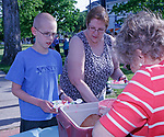 """Winsted, CT 051917MK02 Sheila Sedlack, town clerk, serves a big bowl of strawberry ice cream to (from left) Kaidiyn Carlson and Phyllis Leslie during The town of Winsted ice cream social at East End Park on Friday afternoon.  Candy Perez said the town won the funding for the event by having the most citizens out of twenty-one regional towns complete a questionnaire in the Northwest Hills Council of Governments regional plan resident survey.  Winsted logged 337 responses out of 1370 total. The collected information will help towns, regional non-profits and residents to identify issues, goals and strategies for land use during the next ten years.  Perez said that the Gilbert cafeteria helped to order the treats and McGrane's just off the green kept the twenty four gallons of ice cream frozen.  Perez stated """" Given the large turn out we were all talking that maybe this could become an annual welcome to summer event."""" Michael Kabelka / Republican-American"""