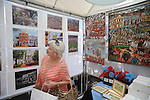 Terry Calcote looks over art at the Double Decker Arts Festival in Oxford, Miss. on Saturday, April 28, 2012.