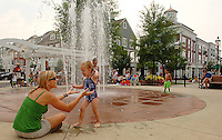 Children play in a water fountain during the annual Fourth of July Celebration and community parade in Birkdale Village in Huntersville, NC. Birkdale Village combines the best of shopping, dining, apartments and entertainment venues within a 52-acre mixed-use development.