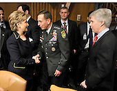 Washington, DC - April 8, 2008 -- United States Senator Hillary Rodham Clinton (Democrat of New York), left, shakes hands with General David Petraeus, center, as he and Ambassador Ryan Crocker, right, prepare to testify before the United States Senate Armed Services Committee on the situation and progress in Iraq in Washington, D.C. on Tuesday, April 8, 2008..Credit: Ron Sachs / CNP