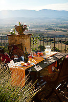 Outdoor dining on the terrace of 'I Cerri' Watch-tower, overlooking the expansive Spoleto Valley, Umbria, Italy
