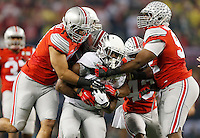 Oregon Ducks running back Royce Freeman (21) gets pushed back by a host of Ohio State Buckeyes defenders in the first quarter of the College Football Playoff National Championship between the Ohio State Buckeyes and the Oregon Ducks at AT&T Stadium in Arlington, Texas, Monday afternoon, January 12, 2015. As of half time the Ohio State Buckeyes led the Oregon Ducks 21 - 10. (The Columbus Dispatch / Eamon Queeney)