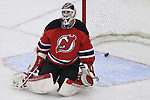 Mar 27; Newark, NJ, USA; New Jersey Devils goalie Martin Brodeur (30) reacts after a goal by Chicago Blackhawks defenseman Brent Seabrook (7) during the third period at the Prudential Center. The Devils defeated the Blackhawks 2-1 in an overtime shootout.