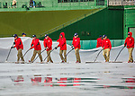 7 April 2016: Member of the Grounds Crew squeegee off the infield tarp after a 90 minute rain delay during the Washington Nationals Home Opening Game against the Miami Marlins at Nationals Park in Washington, DC. The Marlins defeated the Nationals 6-4 in their first meeting of the 2016 MLB season. Mandatory Credit: Ed Wolfstein Photo *** RAW (NEF) Image File Available ***