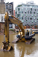 A flooded construction site in the New York neighborhood of Hudson Square from flooding from Hurricane Sandy is seen on Tuesday, October 30, 2012. Hurricane Sandy roared into New York disrupting the transit system and causing widespread power outages. Con Edison is estimating it will take four days to get electricity back to Lower Manhattan. (© Frances M. Roberts)