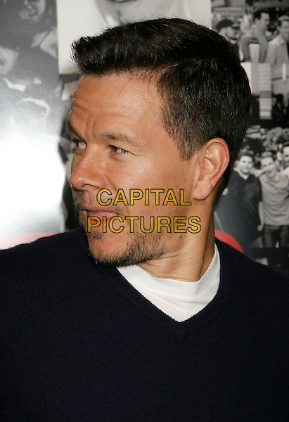 "MARK WAHLBERG.Attending the ""Entourage"" Third Season Los Angeles Premiere held at the ArcLight Cinemas Cinerama Dome. Hollywood, California, USA, 05 April, 2007..portrait headshot profile tongue funny.CAP/ADM/RE.©Russ Elliot/AdMedia/Capital Pictures."