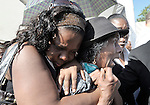 A woman grieves during a January 23 funeral mass for the Roman Catholic archbishop and vicar general of Port-au-Prince, both of whom were killed in the country's earthquake.
