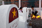 Vietnamese burn paper money offerings for their relatives at a cemetary in Ho Chi Minh City, Vietnam...Kevin German / LUCEO