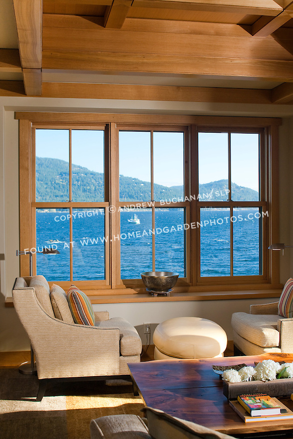 Two chairs offer a place to relax and look out at the water in this Pacific Northwest home. this image is available through an alternate architectural stock image agency, Collinstock located here: http://www.collinstock.com