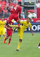 July 27, 2013: Columbus Crew forward Jairo Arrieta #25 and Toronto FC defender Doneil Henry #4 in action during an MLS regular season game between the Columbus Crew and Toronto FC at BMO Field in Toronto, Ontario Canada.