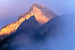 Mist rising around a Canadian Rocky mountain, Banff National Park, Alberta, Canada