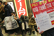 "Homeless men queuing outside the 'Ishimaru' electronics store in Akihabara ""Electric town"" district of the city, the night before the first day of sale of Sony Playstation3 gaming consoles, in Tokyo, Japan, on Friday, Nov. 10, 2006. Many Japanese homeless men were being paid to hold a place overnight in the queue of customers, but declined to say who paid them.  Only 100,000 machines went on sale in Japan, tomorrow, Nov. 11, and will not go on sale in USA and Europe until next year."