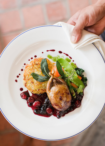 Roasted boneless quail stuffed with Luang Prabang mushrooms with Red Forest Fruit Sauce (Mulberry & Cranberry). Also served with Darphin potatoes, buttered vegetables & a green salad. L'Elephant. Owned by Gilles Vautrin & Yannick Upravan. Luang Prabang, Laos.