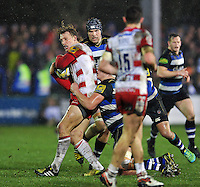 Billy Twelvetrees of Gloucester Rugby is tackled in possession. Aviva Premiership match, between Bath Rugby and Gloucester Rugby on February 5, 2016 at the Recreation Ground in Bath, England. Photo by: Patrick Khachfe / Onside Images