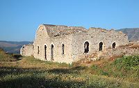 Building with arched doorways and windows in Berat Castle or Kalaja e Beratit, near the White Mosque and the Lord's Fortress, in Berat, South-Central Albania, capital of the District of Berat and the County of Berat. The castle dates mainly from the 13th century and contains Byzantine churches, Ottoman mosques and housing. It is built on a rocky hill on the left bank of the river Osum. Picture by Manuel Cohen