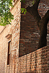 Brick house and tree in narrow Old Street alley, Lugang, Changhua County, Taiwan