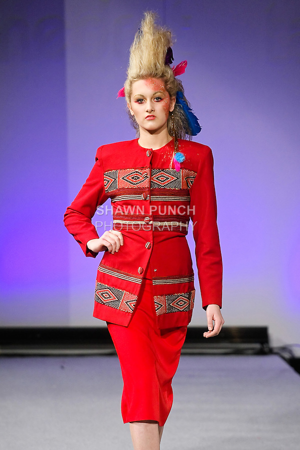 Model walks runway in an outfit by Luis Machicao, from the Luis Machicao Ethnic Fall Winter 2013 collection, during Couture Fashion Week New York Fall 2012.