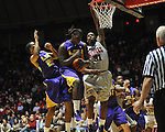 "LSU's Johnny O'Bryant III (2) grabs a rebound against LSU's Ralston Turner (22) and Ole Miss' Murphy Holloway (31) at the C.M. ""Tad"" Smith Coliseum in Oxford, Miss. on Saturday, February 25, 2012. (AP Photo/Oxford Eagle, Bruce Newman).."