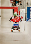 5 December 2015: Eliza Cauce, competing for Latvia, crosses the finish line on her second run of the Viessmann World Cup Women's Luge, with a combined 2-run time of 1:28.486 and a 6th place result at the Olympic Sports Track in Lake Placid, New York, USA. Mandatory Credit: Ed Wolfstein Photo *** RAW (NEF) Image File Available ***