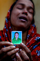 Bilkis Begum shows a picture of her sister who she lost in the blaze at the factory. At least 112 people died, and more than 100 were injured at a fire at the Tazreen Fashions textile factory in Dhaka. Bangladesh's garment industry has a notoriously bad fire safety record; if the right precautions had been taken, the fire could have been prevented.