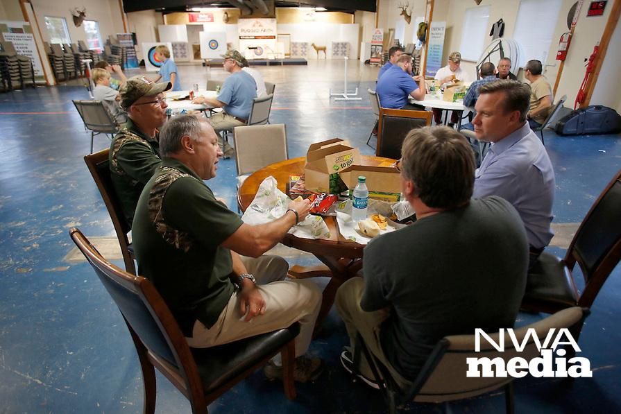 NWA Democrat-Gazette/DAVID GOTTSCHALK  Jim Zalenski (second from left), vice president of Rugged Faith Ministries, enjoys a meal Thursday, October 22, 2015, during fellowship at Rugged Faith in Tontitown.