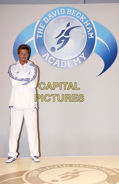 DAVID BECKHAM.The launch of The David Beckham Academy at The Chainstore, Trinity Buoy..March 14th, 2005.full length white adidas track suit arms crossed logo.www.capitalpictures.com.sales@capitalpictures.com.© Capital Pictures.