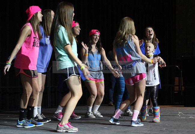 Sisters of the Delta Zeta sorority dance with Bailey, a DanceBlue kid, during the 2015 10th anniversary DanceBlue at Memorial Coliseum on Sunday, February 15, 2015 in Lexington, Ky. Photo by Adam Pennavaria | Staff