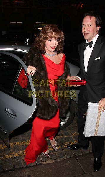 JOAN COLLINS & PERCY GIBSON.Christopher Biggins' 60th Birthday Party at the Landmark Hotel, Marylebone, London, England..December 15th, 2008.full length red dress black brown fur wrap clutch bag tuxedo married husband wife car.CAP/ROS.©Steve Ross/Capital Pictures.