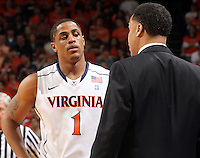 Jan. 27, 2011; Charlottesville, VA, USA; Virginia Cavaliers asscoiate head coach Richtie McKay talks with Virginia Cavaliers guard Jontel Evans (1) during the game at the John Paul Jones Arena. Maryland won 66-42. Mandatory Credit: Andrew Shurtleff