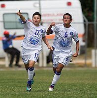 Gerardo Iraheta (17) of El Salvador celebrates his goal with teamma Brayan Landaverde (6) during the group stage of the CONCACAF Men's Under 17 Championship at Jarrett Park in Montego Bay, Jamaica. Costa Rica defeated El Salvador, 3-2.