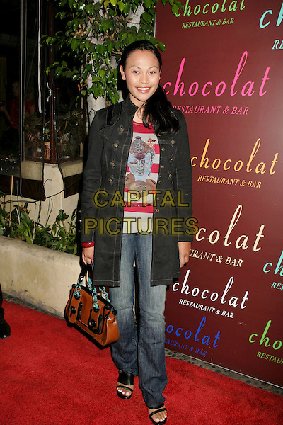 """CASSANDRA HEPBURN.Launch party for the new book """"Dating, Mating, and Manhandling: The Ornithological Guide to Men""""held Chocolat Restaurant and Bar, Los Angeles, California, USA..September 14th, 2006.Ref: ADM/RE.full length jeans denim jacket brown bag purse.www.capitalpictures.com.sales@capitalpictures.com.©Russ Elliot/AdMedia/Capital Pictures."""