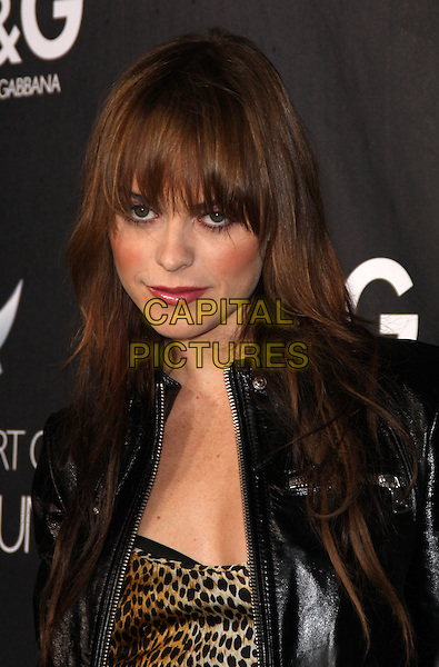 TARYN MANNING .D&G Flagship Opening In Support of The Art of Elysium held at Dolce & Cabana Boutique, West Hollywood, California, USA..December 15th, 2008.headshot portrait fringe bangs black leather leopard print top .CAP/ADM/KB.©Kevan Brooks/AdMedia/Capital Pictures.