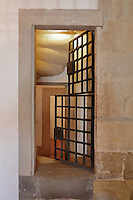 University Prison, with iron door, in use 1541-1834, of which 2 staircases remain, in the Joanina Library, or Biblioteca Joanina, a Baroque library built 1717-28 by Gaspar Ferreira, part of the University of Coimbra General Library, in Coimbra, Portugal. This is the only existing medieval prison in Portugal. The Casa da Livraria was built during the reign of King John V or Joao V, and consists of the Green Room, Red Room and Black Room, with 250,000 books dating from the 16th - 18th centuries. The library is part of the Faculty of Law and the University is housed in the buildings of the Royal Palace of Coimbra. The building is classified as a national monument and UNESCO World Heritage Site. Picture by Manuel Cohen