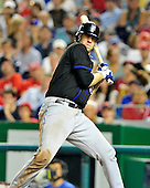 New York Mets catcher Josh Thole (30) back off from a pitch that hit him in the seventh inning against the Washington Nationals at Nationals Park in Washington, D.C. on Saturday, July 30, 2011.  The Nationals won the game 3 - 0..Credit: Ron Sachs / CNP.(RESTRICTION: NO New York or New Jersey Newspapers or newspapers within a 75 mile radius of New York City)