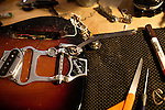 "October 28, 2010. Graham, NC.. A guitar in the process of being fixed  in Fret Sounds, a repair shop owned by guitar player Brian Haran.. Filthybird, a five piece composed of Brian Haran, Renee Mendoza, Sanders Trippe, Jim Bob Aiken and  Mike Duehring, recently released their full length album ""Songs for Other People"" on Holidays for Quince Records.. ."